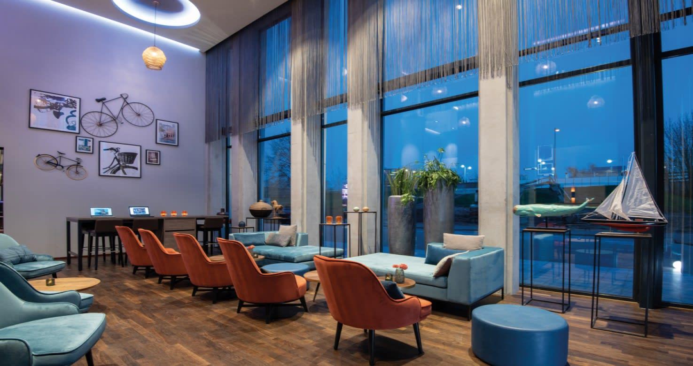 Why is IWG partnering with Leonardo Hotels?